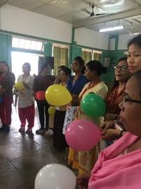 women holding balloons