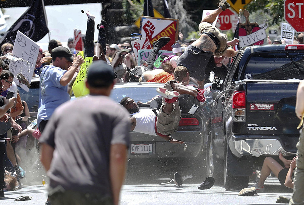 A car crashes into counter protestors in Charlottesville, VA