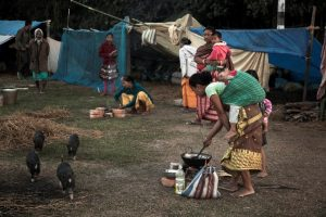 women cooking in camp